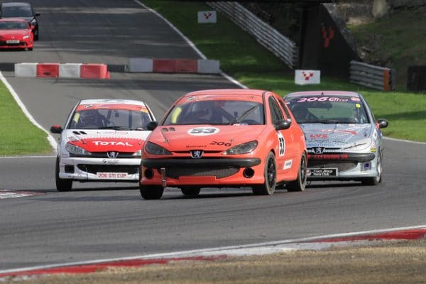 Red 206 GTi racing at Brands Hatch
